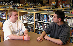 Hopkinton High School students Andrew Ritz and Jake Everett debate healthcare in the library after school. Photo by Nate Clark