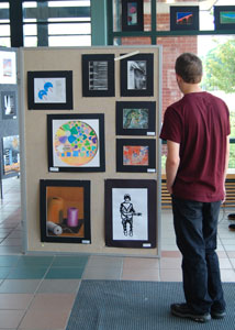 Kyle Bogasky checks out the artwork in the 2010 student art show.  Photo by Shannon Wright
