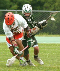 Hopkinton player Pete Racenis battles a Waverly player for a loose ball.