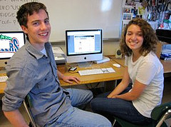 The Satellite's co-editor, Becca Govoni, and one of its contributors, Ryan Page, working on the magazine's new online format. Photo by Kayla Sullivan