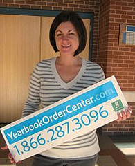 Mrs. Gianino, the yearbook advisor, holding the Yearbook order sign. Photo by Taylor Bush