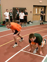 Seniors Kevin Franke (right) and Zach Hutchinson (left) line up for time trials during Hopkinton's first track practice. Photo by Mike Ronan.