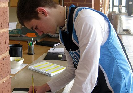 Senior Brendan Litavis signs out of school during one of his free periods.  Photo by Meghan Fleming