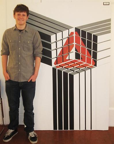 Kyle Bogasky shown here with his largest work of art. Photo by Catherine Leonard