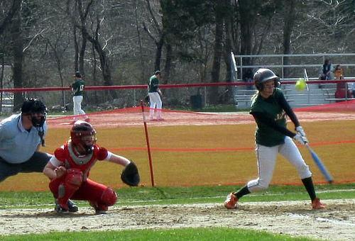 HHS senior Michelle Cooprider hits a single. Photo by Meghan Fleming