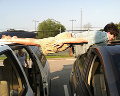 HHS Senior Adrian Emrick planks two cars as part of the new internet craze 'planking' Photo By Ryan McLean