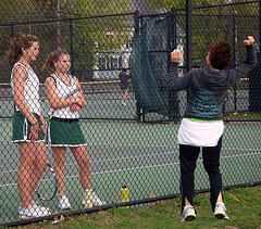 Varsity Girls Tennis players, Abby Normandeau and Bevy Reynolds, get advice from assistant coach, Vivian Normandeau during their match against Holliston on May 3rd. Photo by Allison Langh