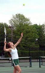 Maddie Schneider serves the tennis ball during the girls varsity tennis match against Whitinsville Christian. Photo by: Allison Langh