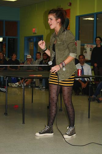International student Maddalena Pizzonia belts out an Italian love song for the audience at Hopkinton High School's International Night.  Photo by Meghan Murdock