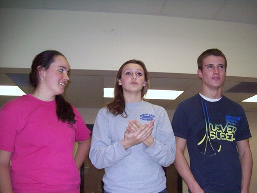 Leo Club officers (on left and right), Katrina Parsons and Joey McNulty with president Hannah Krueger (middle) discuss the upcoming Holiday Party event with members of the community service club. Photo by Shaina Belsky