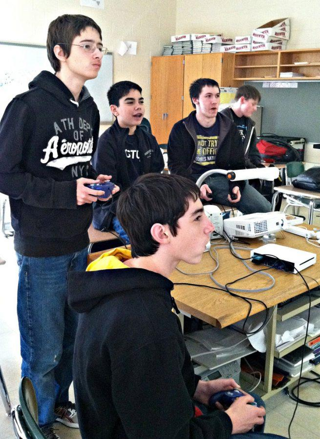 Members of the Games Club relax after school, enjoying a game of Super Smash Brothers Brawl on the Nintendo Wii.  Photo by Meghan Murdock.