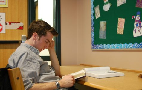 Senior Ryan Page sits in the library and studies for the upcoming tests squeezed in before Winter break.  Photo by John Oldach