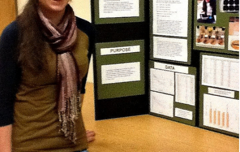 Alexis Stefano stands in front of her 1st prize science fair project entitled