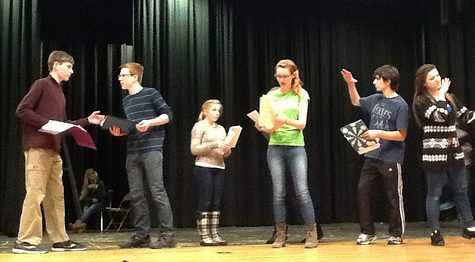 Evelyn Oliver (center), playing Alice Little, and other cast members (left to right) Erik Fliegauf, Jack McCauliffe, Ashley Olafsen, Henry Vumbaca, and Taylor Forsmo prepare the