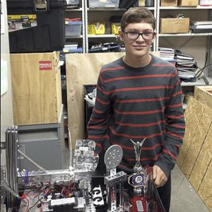 Evan Goldstein, junior, is a three year member and co-leading engineer of the Robotics Club and is working with his team to design new robots for the 2014-2015 school year. Photo by Nikolai Saporoschetz.