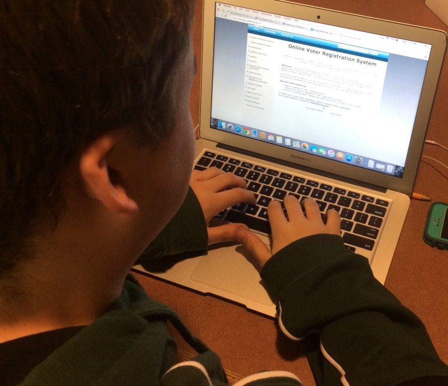 Senior Trevor Perkins filling out the online voter registration form. Photo by Owen McNamara