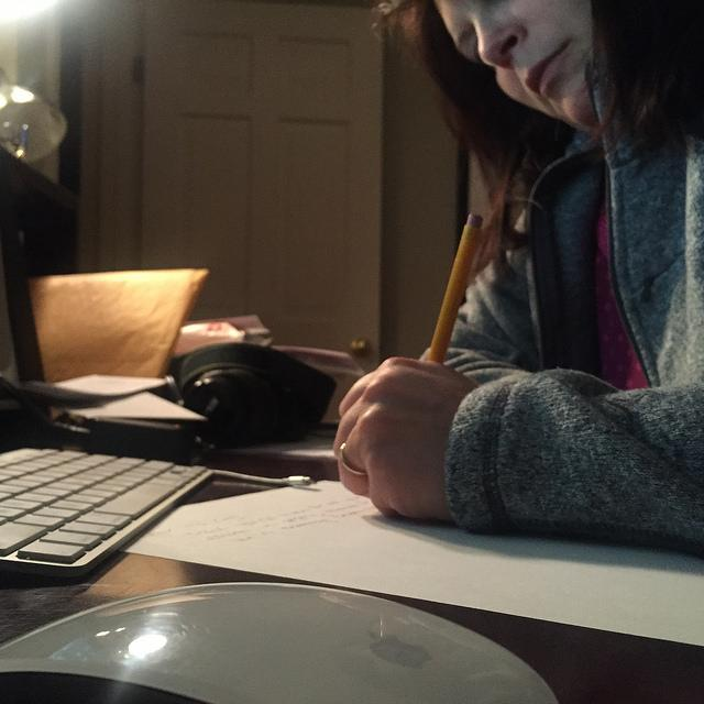 Hopkinton mother Gina Fajardo writing a dismissal note for her daughter. Photo by Michael Fajardo.