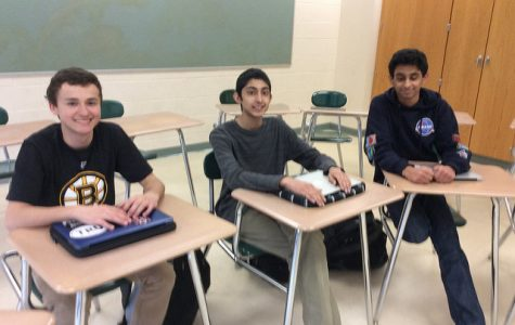 Debate Team members from left to right: Alex Wojick, Maz Ahmad,and Tazwar Ferdous.