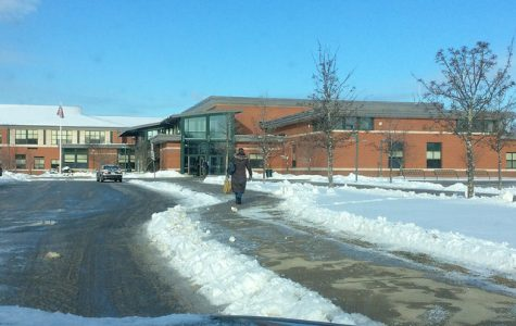 A high school teacher arrives late to school on a snowy April morning. Photo by Josh Normandeau.