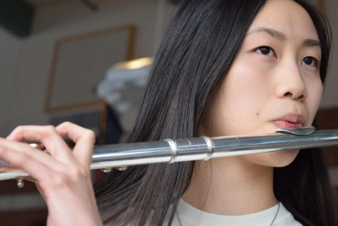 Photo: Rachel Chen playing flute