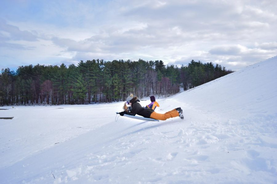 Photo: Jonathan Goldberg and Abby Brown take to the skies as they sled down the Hopkinton State Park dam.