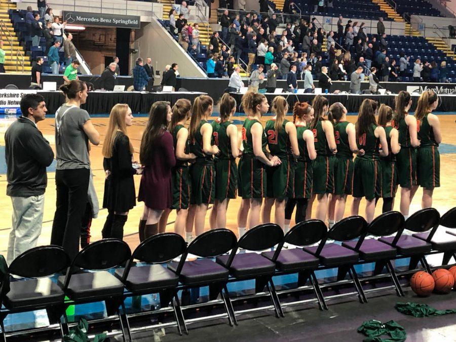 Photo: girls basketball team lined up on sideline