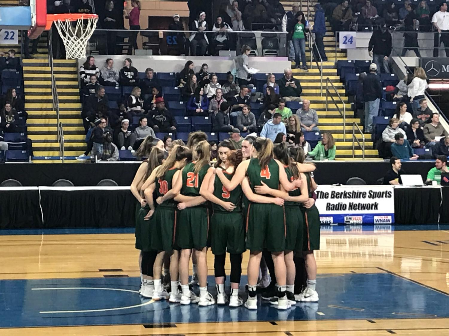 The girls huddle in effort to rally during the final.