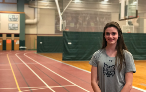 Photo: Caitlyn Halloran smiling on the indoor track