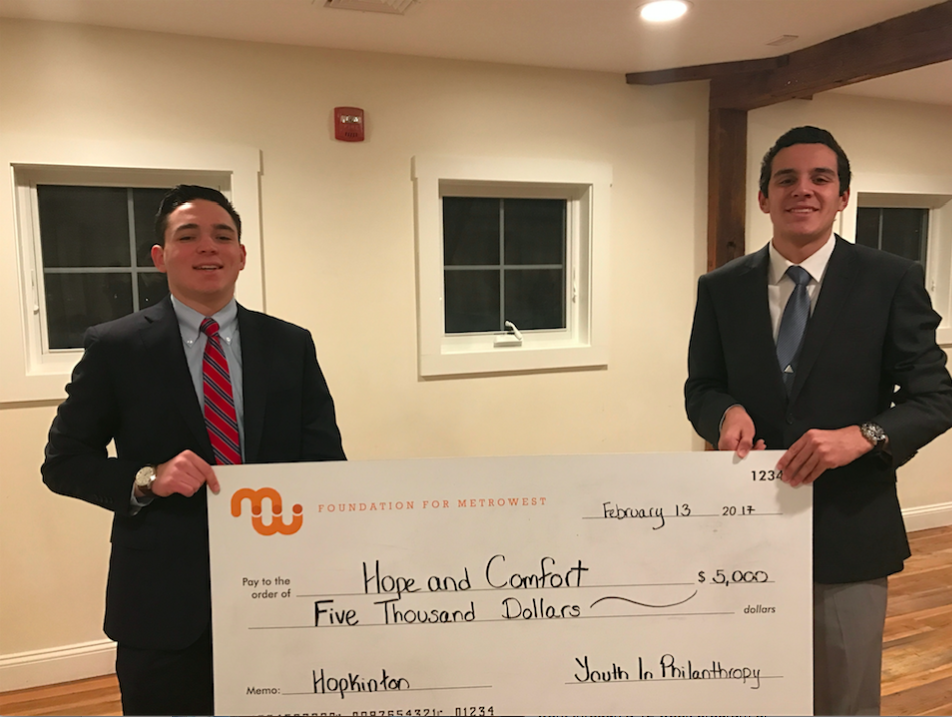 Pictured left to right, Patrick Murphy and Ben Scire granted a $5,000 grant to the non-profit, Hope and Comfort, in which provides health products to people in need.