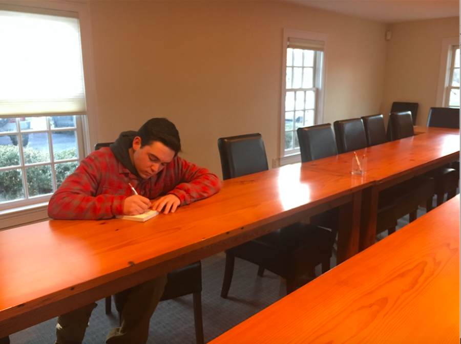 Photo: Patrick Murphy taking notes at a conference table
