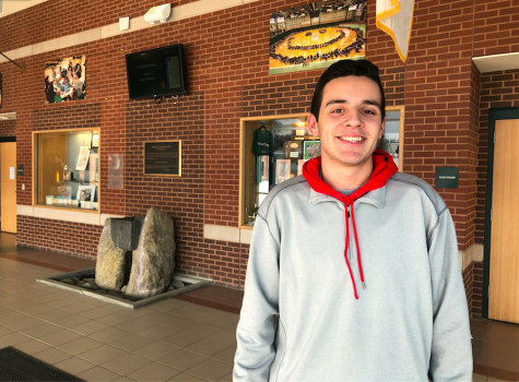 Photo: Ben Scire Smiling in the atrium of Hopkinton High School