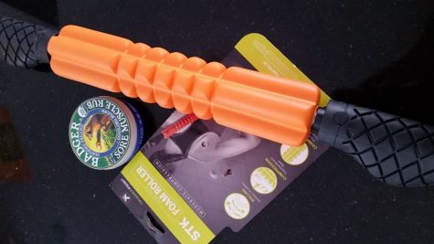 Photo: Sore muscle rub and a new muscle roller for training.