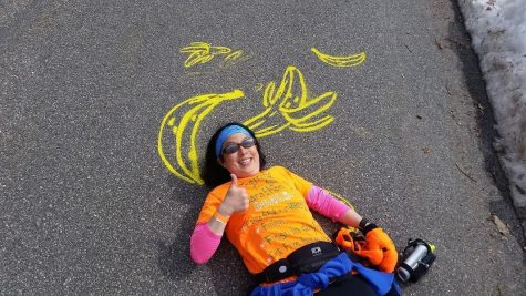 Photo: Denise Antaki posing with the banana she wants at the finish line.
