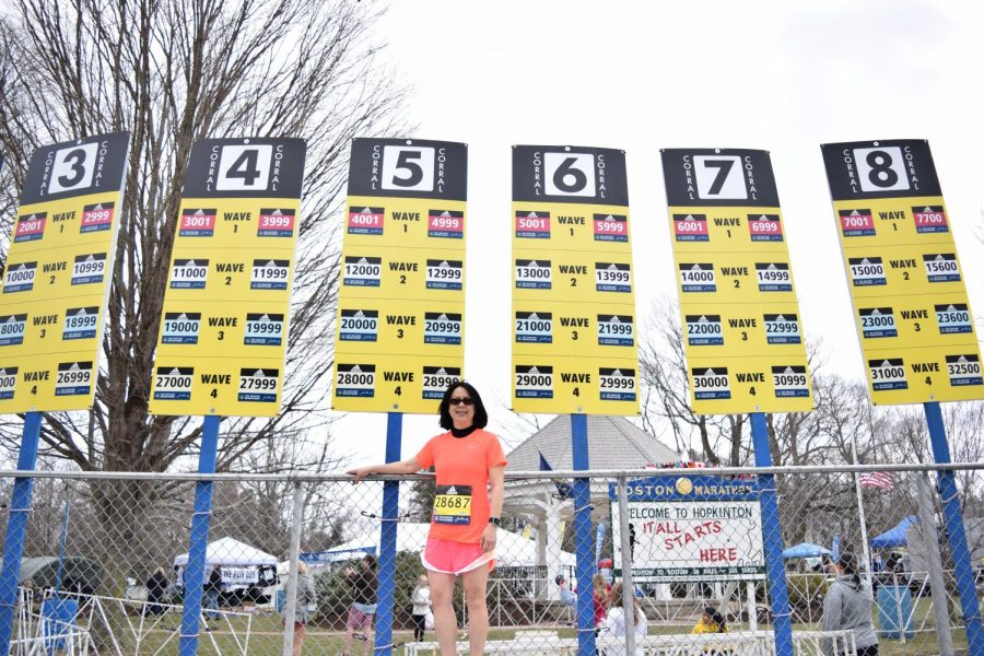 Photo: Denise Antaki standing in front of her corral sign two days before her big run.