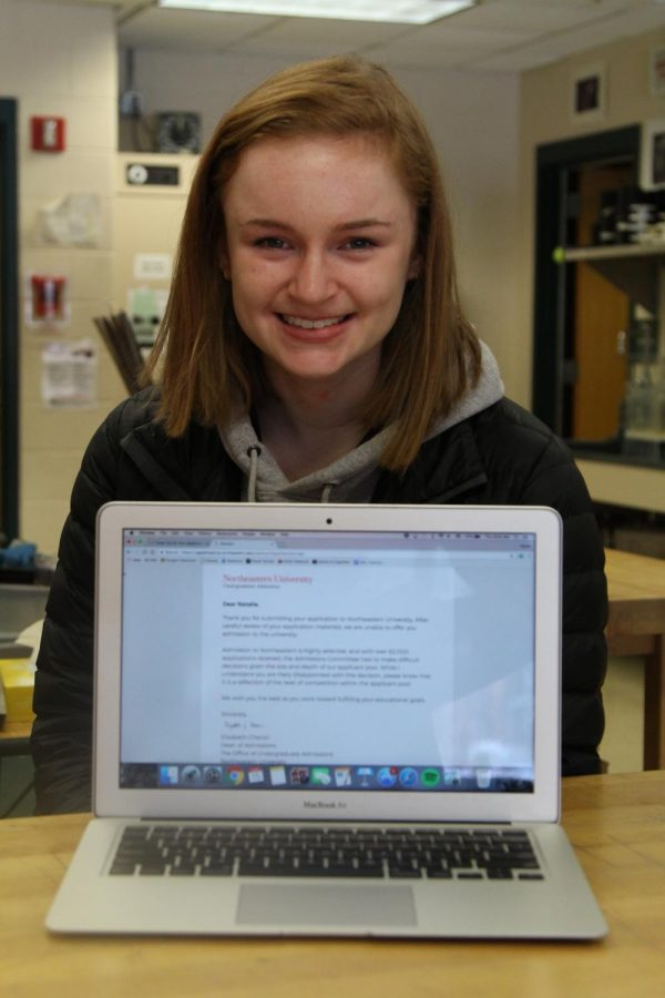 Photo: Senior Natalie White with her rejection letter from Northeastern University.