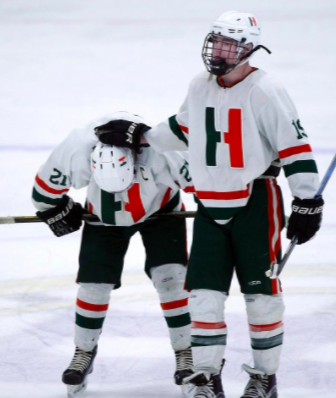 Photo: Tommy Hamblet consoling linemate Owen Delaney after State Sectional Semi-final. Photo by Robin Chan