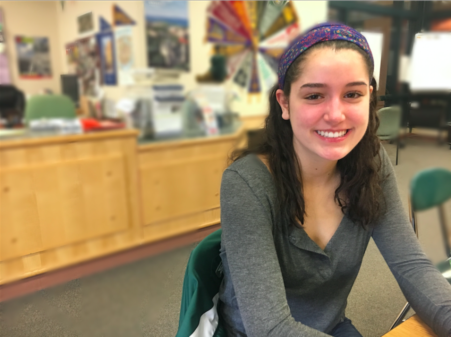 Photo: Zoe Komodromas sitting at a table in guidance.