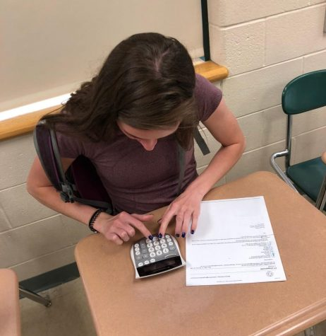 Photo: Senior Caitlyn Halloran doing her classwork.