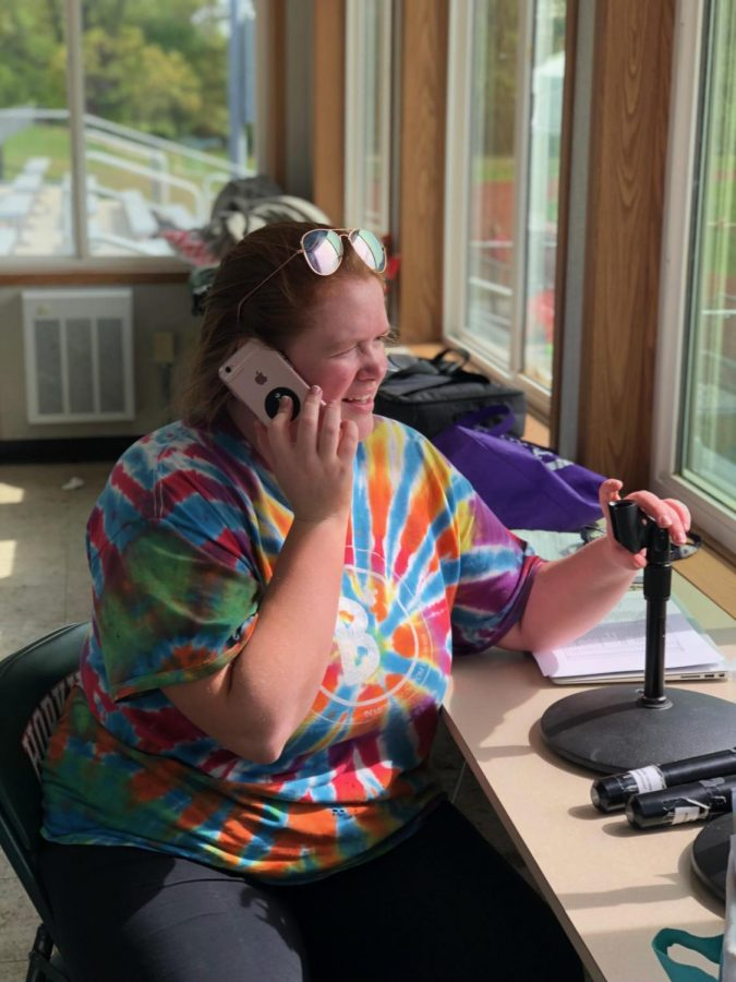 Senior President of Relay For Life, Hannah Murphy, calls for help while setting up the event.