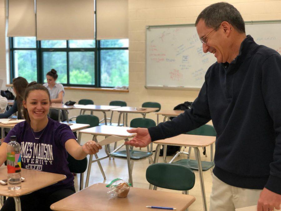 Senior, Elizabeth Liberta, and teacher, Mr. Buffum, as Elizabeth hands in her Class Survey.