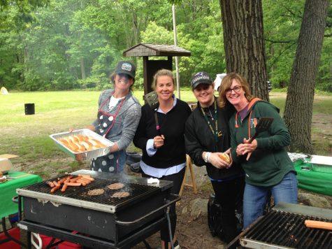 Photo: Parent volunteers preparing food at last years senior picnic.