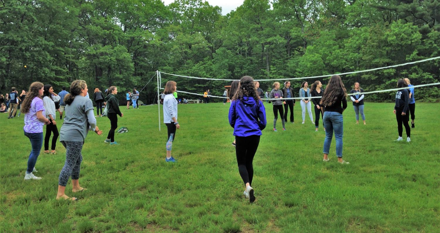 Seniors playing volleyball at the senior picnic.