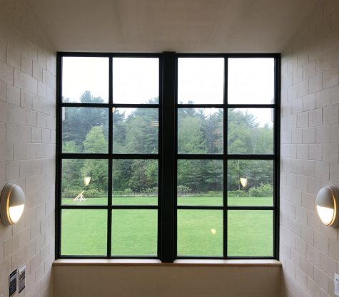 Photo: Bright window on the third floor, with view of a senior project trebuchet.