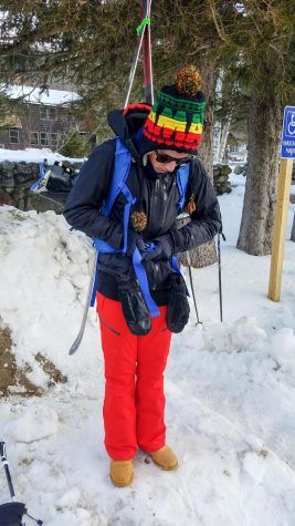Photo: Chris Pomeroy getting situated, strapping his brand new pack to his back in the parking lot of the Pinkham Notch Visitor Center.