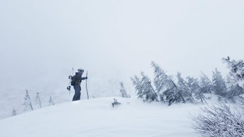 Photo: Lu Wang fighting the howling winds as he makes the final push to the summit of this tiny hill off of the trail.