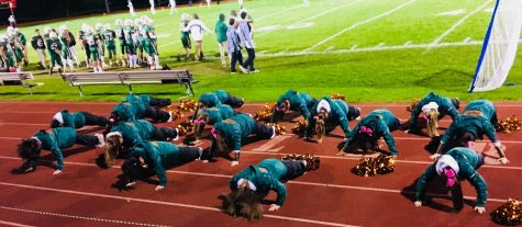 Photo: The cheerleaders do pushups at the homecoming game in celebration of a touchdown.