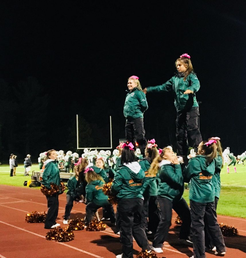 Photo: The cheerleaders prepare for their halftime performance