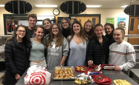 Photo: Ambassadors Club members prepare their regional foods before international night begins.