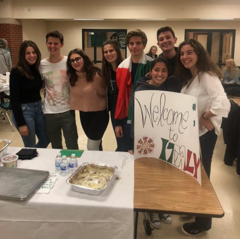 Photo: Ricardo Negri (second from left) Smiles with the other Italian international students at their table during international night.