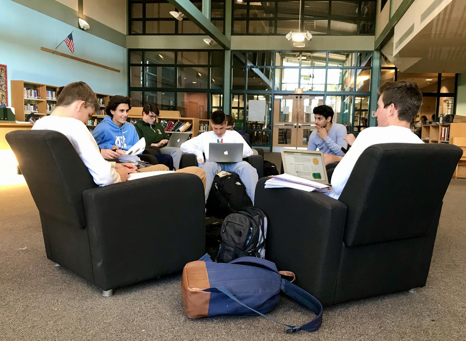 A group of students spend their Hiller Day time doing homework and conversing.